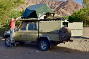 Setting up camp on an african safari, namibia