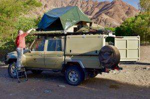 Setting up camp on an african safari, namibia
